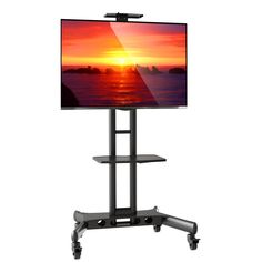 Mount Factory Rolling TV Stand Mobile TV Cart for Flat Screen, LED, LCD, OLED, Plasma, Curved TV's - with Mount for 40 in. - 65 in. Universal Mount with Wheels. Universal fit and compatibility for televisions from 40 - 65 in. Component shelf for cable box, DVD player, etc. Ideal TV display that can move to any room in the home or office. Universal fit - fits VESA hole patterns from 200mm x 200mm to 400mm x 600mm. One piece steel base; sturdy steel frame; rated for televisions up to 100...