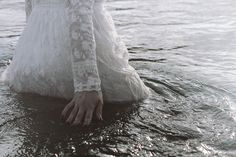 that which is lost to her. (seawater staining her skirts, she sinks her fingers into waters she once called home.)