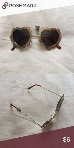 Heart shaped sunnies Never worn, still has a tag. PacSun Accessories Sunglasses