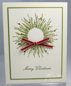 using pocket silhouettes stamp over a masked circle to create a beautiful christmas wreath