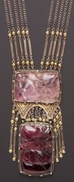 An Arts and Crafts Carved Gem-set Necklace, J. Hartwell Shaw. Composed of multiple strands of fancy link chain suspending bezel-set rose quartz and purple tourmaline tablets enhanced by flexible fringe, applied bead accents, completed by a conforming beaded clasp, gold, silver and silver gilt mount, 27 1/2 and 3 1/2 in., signed J.H. Shaw. #Shaw #ArtsAndCrafts #necklace