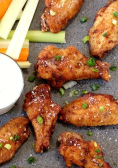 Salt and Vinegar Wings... 1 (48 oz. pkg of 20) chicken wings, ½ tspoon salt ½ tspoon garlic powder ½ tsp Paprika, 1 tsp Sugar, Vegetable Oil for frying Fave Toppings, Malt Vinegar, Kosher or Sea Salt, Ranch or Blue Cheese Dressing/Dip... Preheat oven 475*F. Toss wings in sugar and spices. Bake 15 min until crispy, turning halfway through cooking time. Toss wings with 2T. malt vinegar, and 1 T. Salt. Serve with dressing on the side for dipping.
