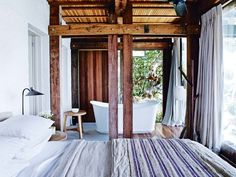 The best bedrooms of 2016: One of Vogue Living's most memorable waterside properties was this Palm Beach home, complete with a spectacular bedroom and adjoining ensuite. Mixing the best of indoor/outdoor living, this bedroom is a perfect example of how to create a liveable yet natural space. See the whole house tour here.  Image credit: Prue Roscoe