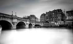 Pont Neuf Paris  This is a photo I took after the flood in Paris I did a 4 minutes exposure. This is a really cool thing to do because the water becomes so reflective that it reflect the white sky and give this cool mood to the photo. It is a bit different but I kinda like it! Do you guys prefer usual long exposure or this kind of long exposure? Let me know!  #photoserge #justgoshoot #monoart_ #bnw_planet #bridge #water #paris #blackandwhite #silky #dodgeandburn #pontneuf #longexposure_shots