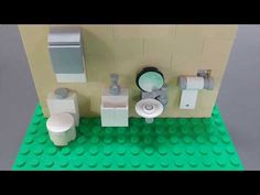 Here is a video showing you how to build some simple bathroom items. In this video is a basic toilet, 2 types of sinks, paper towel dispenser and a toilet pa. Legos, Lego Bathroom, Lego Simpsons, Lego Friends Sets, Lego Furniture, Lego Display, Lego Craft, Lego Modular, Lego Worlds