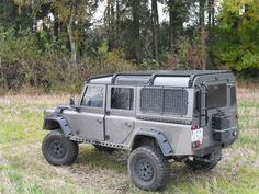 Military Looking 110 with Genesis Tracks roof rack and Hutchinson Wheels
