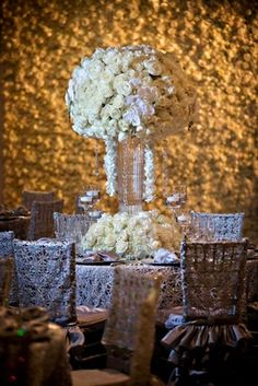 Ivory Wedding Table in Front of Flower Wall    Photography: Kevin Beasley Photographer   Read More:  http://www.insideweddings.com/weddings/opulent-wedding-with-gatsby-inspired-theme-at-louisiana-plantation/747/