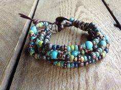 This bracelet is made with turquoise beads 6 mm, metal beads,miyuki beads,leather and a metal button.  Fits a wrist of 15 cm = 5.905 inch.  Please