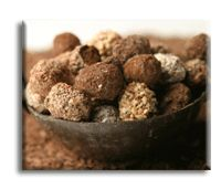 """Chocolate Cheese Balls, also known as """"Truffles"""" are a really delicious cream cheese dessert that are easy to make. Your friends and family will be impressed when they see these on the table. The flavors of chocolate, strawberry preserves and toasted almonds combine for a flavor explosion in your mouth."""