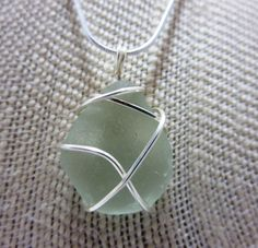 Frosted white sea glass necklace wrapped in silver wire  - handmade, recycled, eco-friendly #bestofEtsy #gifts