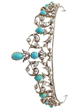 A Victorian convertible tiara / necklace made with turquoise and diamonds. Made of I8k gold and silver.
