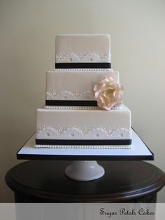 scalloped edge detail wedding cake with pearls in black, cream and white. lovely!