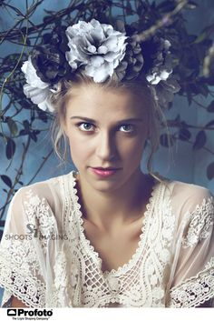 Beautiful blond woman with braid hairstyle and natural makeup. Wearing ping bohemian sequin and feather dress. Against blue grunge background - stock photo Feather Dress, Natural Make Up, Vintage Lace, Flower Crown, Braided Hairstyles, Royalty Free Stock Photos, Braids, Sequins, Bohemian