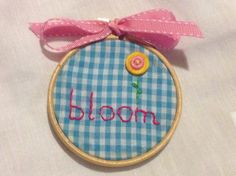 Embroidery on pretty gingham fabric with a cute button flower