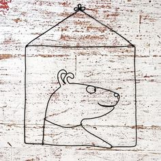 Dog three, the picture is made of wire