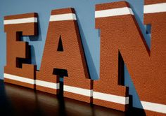 Decor for a football themed bedroom. Football letters. Perfect addition to the room  Theraggedwren.blogspot.com