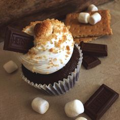 Our very own s'mores cupcakes! Decadent chocolate cake baked over graham cracker crust, topped with marshmallow frosting, and mini roasted marshmallows! Keep an eye out for the recipe on our upcoming blog!