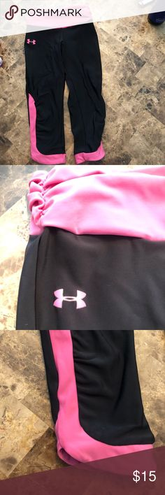 Women's XS Under Armour Capris Black UA workout capris with pink accents. In very good used condition with lots of life left. Super cute addition to your workout wardrobe. Under Armour Pants Capris