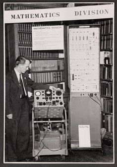 Alan Turing's first assistant Mike Woodger demonstrating the ACE simulator in 1950 at the Royal Society.