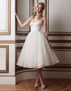Justin Alexander wedding dresses style 8800 Regal satin and tulle tea length ball gown accented by a sweetheart neckline.