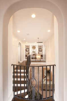 An archway over your staircase keeps you connected to what's going on downstairs. Seen in Montalcino Estates, a Dallas community.