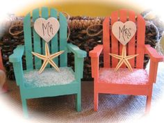 """This listing is for a pair of Beach/Destination theme wedding cake topper in choice of 5 colors.On each chair is a sprinkling of """"beach sand"""" and a starfish. (Starfish is left unattached so that you may position it where you like.)Rest assured, the sand is firmly secured in place!These colorful, eye popping chairs come in your choice of color of either Coral, Sea Glass Aqua, Turquoise, White or Blue Lagoon. (Sea Glass Aqua and Coral are in the first photo, Turquoise in the second..."""