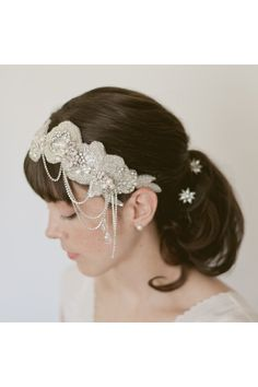 Close fitting cloche style headband of floral beaded appliques with draping thin rhinestone chains.  Yeah, this one's pretty awesome :)