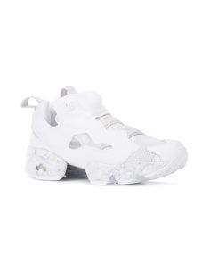 Almost 25 years after its debut (and countless seasons as a cult favourite), the Reebok InstaPump Fury is making a comeback as one of the 'It' sneakers of 2017. Shop now at Farfetch