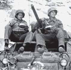 Two members of the Brazilian Expeditionary Force eat their lunch on top of an M8 Greyhound. As part of the integration into the US command, the Brazilians were not only rearmed, but also given American style uniforms. The star on the M8, signifying its previous owner, has barely been wiped off to be replaced with the Southern Cross that denoted Brazilian vehicles.
