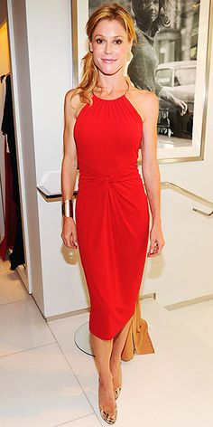 Simple and elegant.  Love the gathered/knotted waist and the red!  (Julie Bowen in a Michael Kors ring halter, golden cuff and nude pumps at the Saban Free Clinic event at the Michael Kors store.)