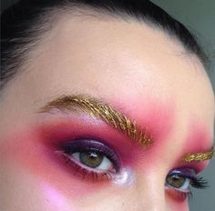 Stunning,bold eye makeup with gold brows