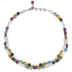 DIAMOND AND GEM SET NECKLACE, 'ALLEGRA', BULGARI Designed as of two rows of variously cut gemstones including blue topaz, amethyst, peridot, citrine, and tourmaline, between bar spacers set with brilliant-cut diamonds, signed Bulgari, Italian assay marks, length approximately 410mm.