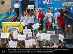 Animal rights activists storm the podium following the annual Forth of July 2015 Nathan's Famous Hot Dog Eating Contest in Brooklyn, NY #CF