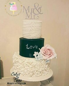 Beautiful ruffle effect wedding cake with chalk effect middle tier and roses.
