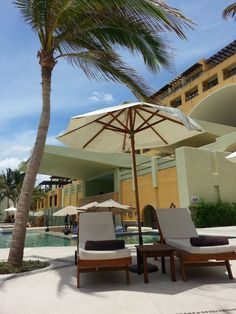 Take cover under the poolside umbrella or the coconut tree! - its hot in Los Cabos!