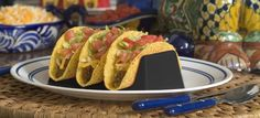 """Taco Holder size 6"""" x 3"""" x 2"""" Designed to hold 3 tacos upright for easy filling and eating. Dishwasher safe, microwaveable and stack easily for storage. Best of all, the Taco Holder is unbreakable. Gr"""