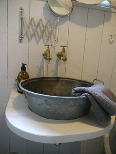 Great galvanized vessel sink! Nice rustic bathroom touch.