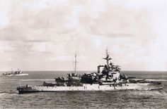 Heavily modernised WW1 era 15 in Queen Elizabeth class battleship HMS Warspite pictured in the Mediterranean in 1943: she accumulated more battle honours across both World Wars than any other capital ship. The picture pre-dates the Salerno operation that September, when a glider bomb hit put her 'C' turret out of commission permanently.