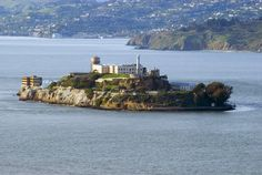 "Alcatraz Island is located in the San Francisco Bay, 1.5 miles offshore from San Francisco, California,  Often referred to as ""The Rock"", the small island was developed with facilities for a lighthouse, a military fortification, a military prison, and a federal prison from 1933 until 1963."