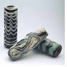 Syrian Islamic folded glass beads from 700 to 1100 A.D.
