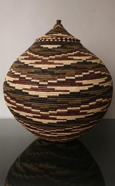 Ukhamba basket | These are traditionally woven by the bride to be or given to the new couple as a wedding gift ~ during the Zulu wedding, the basket will be used to hold ceremonial beer.