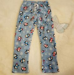 This is a pair of womens Meglilly penguine soft, fuzzy/fleece pajama bottoms size large. They have a drawstring ribbon at waist. They are in good overall condition. 100% polyester. I apologize for the inconvenience, but this is my policy. | eBay!