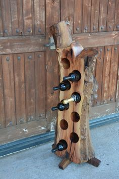 Tree Trunk Wine Rack by TridentWoodworking on Etsy