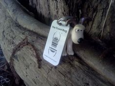 (TB6CFXW) Travel Bug Dog Tag - Gromit Come Home