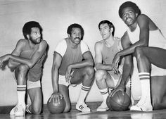 """The Bulls had their first taste of success starting in 1970, when they posted four consecutive seasons with 50 or more wins. On those teams were Norm Van Lier (from left), team captain Chet Walker, Jerry Sloan, whose nickname was """"The Original Bull,"""" and Bob Love."""