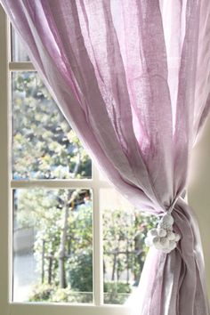lilac curtain tied back for the view