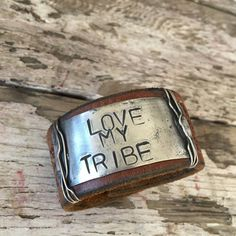 """Handcrafted Leather cuff. I have stamped """"LOVE MY TRIBE"""" on this. The leather is from a recycled Leather Belt. This cuff will fit wrists up to 7 1/2"""" as a watch band type fit. The leather is about 1 1"""