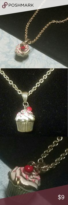 """Colette Hayman's """"Cupcake"""" Necklace 16"""" + 3"""" extender w/lobster clasp closure. Gold chain with cupcake pendant. White frosting, pink sprinkles, and a cherry on top....it's delicious! Item#N313 ALL JEWELRY IS NWT/NWOT/UNUSED VINTAGE  25% OFF BUNDLES OF 3 OR MORE ITEMS. BUY WITH CONFIDENCE, TOP 10% SELLER, FAST SHIPPING, 5 STAR RATING. FREE GIFT(S) WITH MOST ORDERS! Colette Hayman  Jewelry Necklaces"""