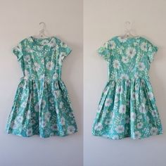Vintage 1960s day dress Authentic 1960s aquatic floral day dress. Natural waist fit, buttons down front to waistline, slightly flared skirt with front exposed pockets. Very good condition, was taken in to fit smaller, tear in pocket was mended and belt loops removed Vintage Dresses