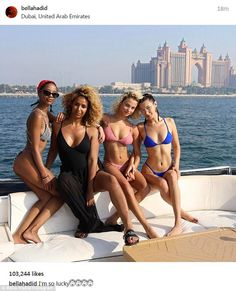Bikini babe: Bella Hadid posed on a boat on Sunday as she enjoyed her time in Dubai with pals